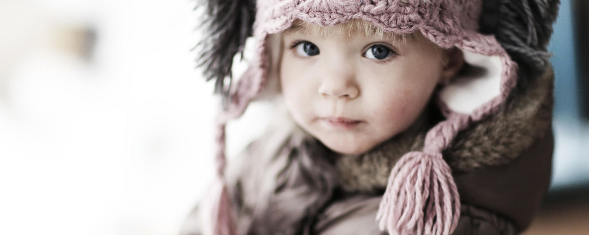 Photograph of a child in a knitted hat
